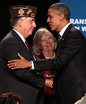 Presiden Barack Obama greets John and Cecile McNeill, of Kansas City, after speaking at the 113th National Convention of the Veterans of Foreign Wars in Reno, Nev., on Monday, July 23, 2012..Photo by Cathleen Allison
