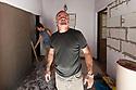 Mèrcuris 30 de martzu de su 2011 Buenos Aires - San Isidro (Argentina) <br /> Gabriele Onnis, a pustis de àere coladu carchi annu in Germània, si nch'est tramudadu pro motivos familiares in Argentina. Istat in San Isidro, unu comunu de Buenos Aires Manna e traballat in s'àmbitu de s'edilìtzia. Inoghe est fotografadu mentres traballat, cun unu dipendente suo, pro torrare a nou un'apartamentu privadu. Est nàschidu in Biddanoa 'E Tulu. <br /> <br /> Mercoledì 30 marzo 2011 Buenos Aires - San Isidro (Argentina) <br /> Gabriele Onnis, dopo aver trascorso alcuni anni in Germania, si è trasferito per motivi familiari in Argentina. Vive a San Isidro, un comune della Grande Buenos Aires e lavora nel campo dell'edilizia. Qui è ritratto mentre si occupa, insieme ad un suo dipendente, della ristrutturazione di un appartamento privato. È nato a Villanovatulo. <br /> <br /> Wednesday 30th March 2011 Buenos Aires - St. Isidro (Argentina) <br /> Gabriele Onnis, after having spent some years in Germany, has moved to Argentina for family reasons. He lives in St. Isidro, a municipality of Great Buenos Aires and works in the field of construction. Here is portrayed while, together with one of his employees, is renovating a private flat. He was born in Villanovatulo.