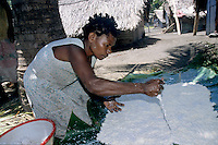 Woman preparing traditional laplap dishes, Sulphur Bay Village, Ipekel Ipeukel, Tanna Island, Vanuatu.