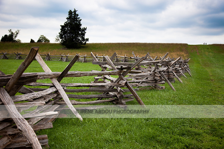 An old-style wood fence surrounds the Stone House at Manassas National Battlefield Park in Virginia.