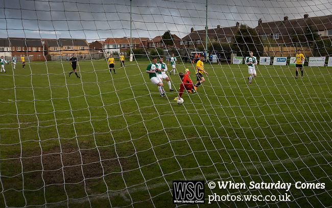 The home team scoring their third goal at Mount Pleasant as Marske United (in yellow) take on Billingham Synthonia in a Northern League division one fixture. Formed in 1956 in Marske-by-the-Sea, the home club had secured automatic promotion to the Northern Premier League two days before and were in the midst of a run of six home games in 10 days as they attempted to overtake Morpeth Town to win the league. They won this match 6-1 against already relegated Billingham, watched by a crowd of 196.