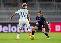 ORLANDO, FL - FEBRUARY 24: Yamila Rodriguez #11 of Argentina is defended by Kelley O'Hara #5 of the USWNT during a game between Argentina and USWNT at Exploria Stadium on February 24, 2021 in Orlando, Florida.