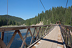 One of several suspension bridges providing back country access to the Clearwater National Forest for U.S. Highway 12.  Lochsa River, Idaho, Lewis and Clark Scenic Byway, U.S. Highway 12 flows west from headwaters near Lolo Pass