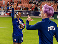 HOUSTON, TX - JUNE 10: Crystal Dunn #19 and Megan Rapinoe #15 of the USWNT listen to the crowd afterg a game between Portugal and USWNT at BBVA Stadium on June 10, 2021 in Houston, Texas.