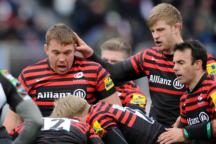 20130324 Copyright onEdition 2013©.Free for editorial use image, please credit: onEdition..John Smit of Saracens is congratulated by team mate George Kruis during the Premiership Rugby match between Saracens and Harlequins at Allianz Park on Sunday 24th March 2013 (Photo by Rob Munro)..For press contacts contact: Sam Feasey at brandRapport on M: +44 (0)7717 757114 E: SFeasey@brand-rapport.com..If you require a higher resolution image or you have any other onEdition photographic enquiries, please contact onEdition on 0845 900 2 900 or email info@onEdition.com.This image is copyright onEdition 2013©..This image has been supplied by onEdition and must be credited onEdition. The author is asserting his full Moral rights in relation to the publication of this image. Rights for onward transmission of any image or file is not granted or implied. Changing or deleting Copyright information is illegal as specified in the Copyright, Design and Patents Act 1988. If you are in any way unsure of your right to publish this image please contact onEdition on 0845 900 2 900 or email info@onEdition.com