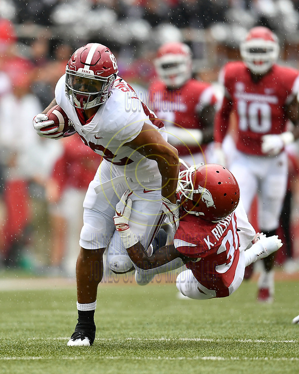 Alabama tight end IRV SMITH JR.(82) is tackled Arkansas defensive back Kevin Richardson III during Saturday's game at Donald W. Reynold Razorback Stadium in Fayetteville.