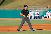 Umpire Matthew Brown prepares for a pitch during the game between the Chattanooga Lookouts and the Tennessee Smokies at Smokies Stadium on June 18, 2021, in Kodak, Tennessee. (Danny Parker/Four Seam Images)