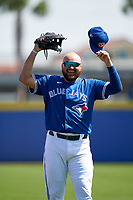 Toronto Blue Jays Rowdy Tellez (44) jokes with a fan during warmups before a Major League Spring Training game against the Pittsburgh Pirates on March 1, 2021 at TD Ballpark in Dunedin, Florida.  (Mike Janes/Four Seam Images)