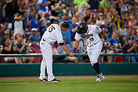 Kane County Cougars third baseman Eudy Ramos (19) is congratulated by manager Blake Lalli (15) as he rounds third base after hitting a home run in the bottom of the fifth inning during a game against the West Michigan Whitecaps on July 19, 2018 at Northwestern Medicine Field in Geneva, Illinois.  Kane County defeated West Michigan 8-5.  (Mike Janes/Four Seam Images)
