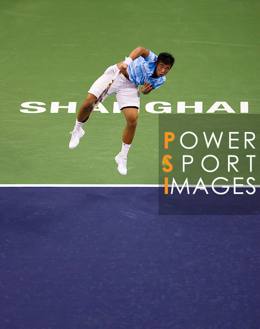 SHANGHAI, CHINA - OCTOBER 12:  Ze Zhang of China serves against Ivan Ljubicic of Croatia during day two of the 2010 Shanghai Rolex Masters at the Shanghai Qi Zhong Tennis Center on October 12, 2010 in Shanghai, China.  (Photo by Victor Fraile/The Power of Sport Images) *** Local Caption *** Ze Zhang