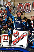 Monster Energy NASCAR Cup Series<br /> Go Bowling 400<br /> Kansas Speedway, Kansas City, KS USA<br /> Saturday 13 May 2017<br /> Martin Truex Jr, Furniture Row Racing, Auto-Owners Insurance Toyota Camry celebrates is win in Victory Lane<br /> World Copyright: Nigel Kinrade<br /> LAT Images<br /> ref: Digital Image 17KAN1nk09957
