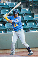 Jorge Alfaro (24) of the Myrtle Beach Pelicans waits for his turn to bat against the Winston-Salem Dash at BB&T Ballpark on July 16, 2014 in Winston-Salem, North Carolina.  The Pelicans defeated the Dash 6-2.   (Brian Westerholt/Four Seam Images)