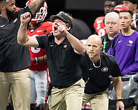 ATLANTA, GA - DECEMBER 7: head coach Kirby Smart of the Georgia Bulldogs signals a play during a game between Georgia Bulldogs and LSU Tigers at Mercedes Benz Stadium on December 7, 2019 in Atlanta, Georgia.