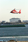 TOKYO - JANUARY 06: Fire-fighting vessels air-lift a person to safety during the New Year's fire review conducted by the Tokyo Fire Department at Tokyo Big Sight on January 6, 2010 in Tokyo, Japan. The annual event, featuring various demonstrations of the latest firefighting and emergency rescue techniques, aims to promote the prevention of fire and disaster. About 2,700 professional firefighters and members of community-based fire companies in Tokyo and 137 fire vehicles, helicopters and ships were mobilized for the annual demonstration. (Photo by Laurent Benchana/Nippon News)