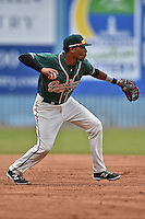 Greensboro Grasshoppers shortstop Rehiner Cordova #11 fields and throws to first during a game against the  Asheville Tourists at McCormick Field June 29, 2014 in Asheville, North Carolina. The Grasshoppers defeated the Tourists 4-0. (Tony Farlow/Four Seam Images)