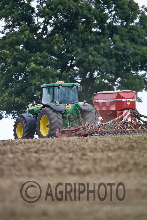 John Deere Tractor drilling winter wheat with a Simba drill.©Tim Scrivener,Vine Cottage,Barholm,Stamford,.Lincolnshire,PE9 4RA.