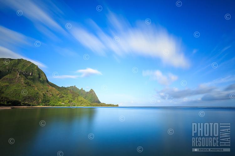 Tunnels Beach and Makana Mountain (or Mt. Makana) on a morning of complete calm, North Kaua'i.