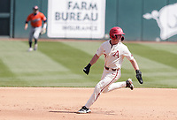 Arkansas Cayden Wallace (7) runs to third, Saturday, April 3, 2021 during the fourth inning of a baseball game at Baum-Walker Stadium in Fayetteville. Check out nwaonline.com/210404Daily/ for today's photo gallery. <br /> (NWA Democrat-Gazette/Charlie Kaijo)