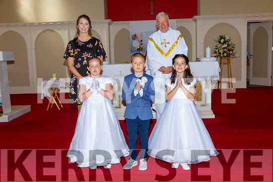 Pupils from Ballincrossig NS who received their first Communion from Fr. Brendan Walsh, PP Ballyduff in St . Peter's & Paul's Church, Ballyduff on Saturday last. Front: Megan Tees, Christian Lawlor & Anna Rose Lopez Phelan. Back: M/s Philomena Knightly & Fr. Brendan Walsh.