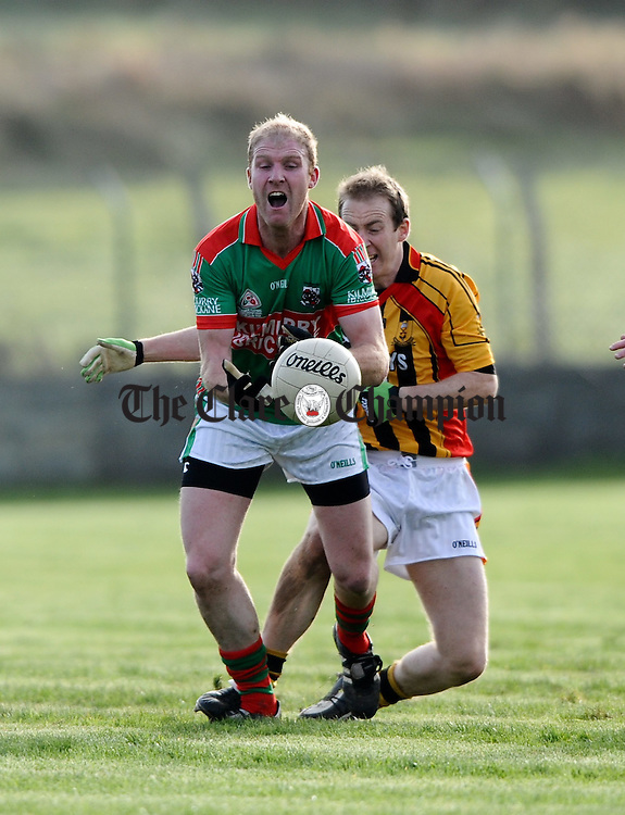 Kilmurry Ibrickane's Paul O Connor is tackled by Michael Reidy of Dromcollogher/Broadford during their Munster Club quarter final at Quilty. Photograph by John Kelly.