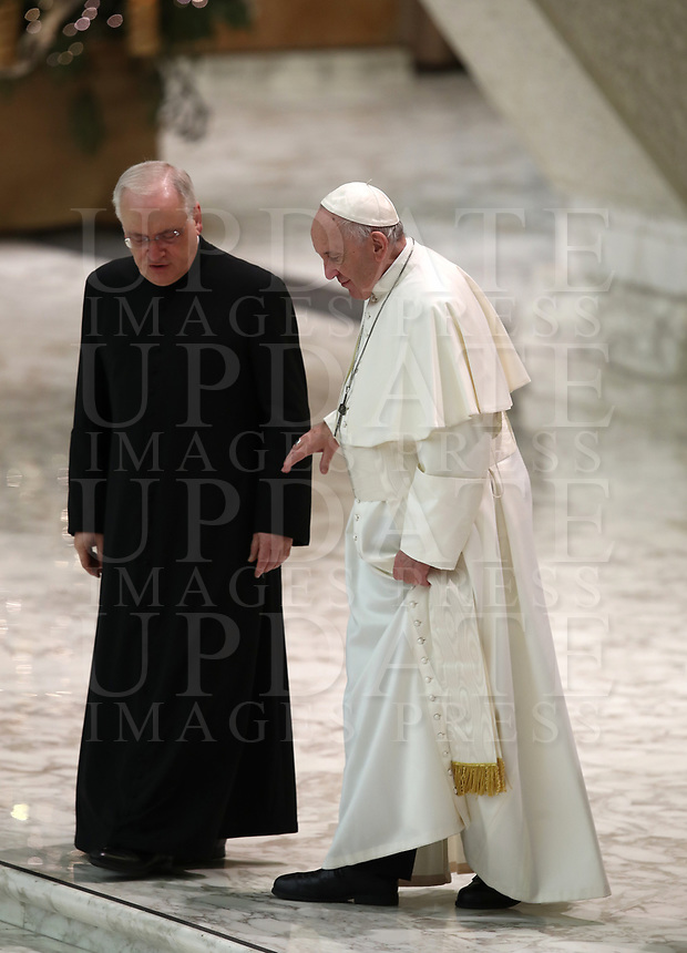 Papa Francesco parla con Monsignor Leonardo Sapienza (s) al termine dell'udienza Generale del mercoledi' in aula Paolo VI in Vaticano, 9 gennaio 2019.<br /> Pope Francis speaks with Monsignor Leonardo Sapienza (L) at the end of his weekly general audience in Paul VI Hall at the Vatican, on January, 2019.<br /> UPDATE IMAGES PRESS/Isabella Bonotto<br /> <br /> STRICTLY ONLY FOR EDITORIAL USE