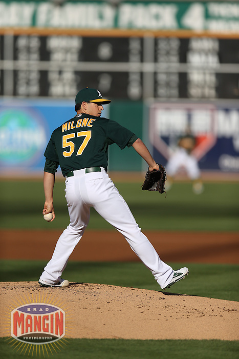 OAKLAND, CA - MAY 18:  Tommy Milone #57 of the Oakland Athletics pitches against the Kansas City Royals during the game at O.co Coliseum on Saturday May 18, 2013 in Oakland, California. Photo by Brad Mangin