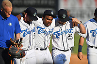 Asheville Tourists Luis Santana (3) is helped from the field by team mates after being injured making the turn on a double play attempt during a game against the Aberdeen IronBirds on June 18, 2021 at McCormick Field in Asheville, NC. (Tony Farlow/Four Seam Images)