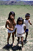 Amazon, Brazil. Macuxi children smiling and waving to the camera.