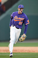 Third baseman Patrick Cromwell (25), right, of the Clemson Tigers shouts as he celebrates the final out of a 5-1 win over the South Carolina Gamecocks in the Reedy River Rivalry game on Saturday, March 3, 2018, at Fluor Field at the West End in Greenville, South Carolina. (Tom Priddy/Four Seam Images)
