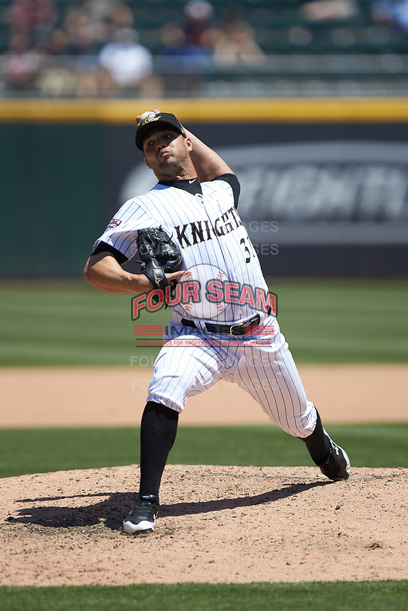 Charlotte Knights relief pitcher Xavier Cedeno (31) in action against the Gwinnett Stripers at BB&T BallPark on May 2, 2018 in Charlotte, North Carolina.  The Knights defeated the Stripers 6-5.  (Brian Westerholt/Four Seam Images)