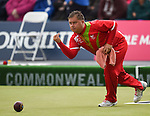Wales Paul Taylor in action against Northern Ireland<br /> <br /> Photographer Ian Cook/Sportingwales<br /> <br /> 20th Commonwealth Games - Lawn Bowls -  Day 4 - Sunday 27th July 2014 - Glasgow - UK