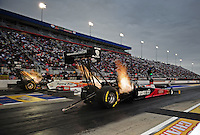 Sept. 16, 2011; Concord, NC, USA: NHRA top fuel dragster driver Rod Fuller (near lane races alongside Clay Millican during qualifying for the O'Reilly Auto Parts Nationals at zMax Dragway. Mandatory Credit: Mark J. Rebilas-US PRESSWIRE