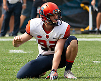 Syracuse holder Nolan Cooney gets ready to recieive a snap from center for an extra point. The Pitt Panthers defeated the Syracuse Orange 44-37 in overtime at Heinz Field in Pittsburgh, Pennsylvania on October 6, 2018.