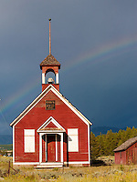 As we approched Leadville from the south, we watched storm clounds develop.  As we got closer, a rainbow formed in front of the dark-gray/blue clouds.  Remembering this schoolhouse from previous visits, I could only cross my fingers and hope the rainbow lasted until we got there.  It did!<br /> <br /> Canon EOS 5D, 70-200 f/2.8L lens