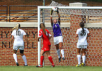 WINSTON-SALEM, NORTH CAROLINA - September 01, 2013:<br /> Shannon Dennehey (6) of Louisville University watches Aubrey Bledsoe (1) of Wake Forest University make a save during a match at the Wake Forest Invitational tournament at Wake Forest University on September 01. The match was abandoned early in the second half due to severe weather with Wake leading 1-0.