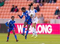 HOUSTON, TX - JANUARY 31: Nerilia Mondesir #10 of Haiti goes up for a header with Melissa Herrera #7 of Costa Rica during a game between Haiti and Costa Rica at BBVA Stadium on January 31, 2020 in Houston, Texas.