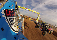 Dec. 11, 2011; Chandler, AZ, USA; Onboard view from the truck of LOORRS pro two unlimited driver Robby Woods as Kyle LeDuc jumps on the inside during the Lucas Oil Challenge Cup at Firebird International Raceway. Mandatory Credit: Mark J. Rebilas-