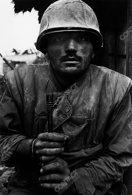 Shell-shocked US soldier awaiting transportation away from the frontline, Têt offensive, Battle of Hué, Vietnam, February 1968