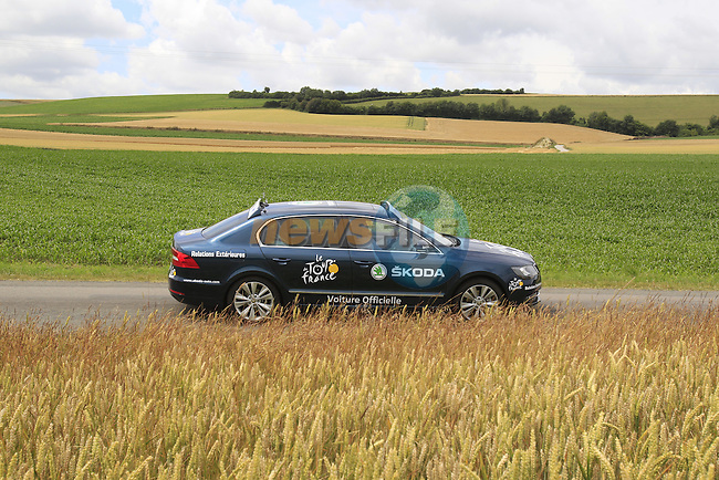 ASO Skoda car passes through rural landscape near Bemont during Stage 4 of the 2014 Tour de France running 163.5km from Le Touquet to Lille. 8th July 2014.<br /> Picture: Eoin Clarke www.newsfile.ie