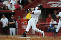 Third Baseman LB Dantzler #20 of the South Carolina Gamecocks connects for a home run during a game against the South Carolina Gamecocks at Carolina Stadium on March 3, 2012 in Columbia, South Carolina. The Gamecocks defeated the Tigers 9-6. Tony Farlow/Four Seam Images.