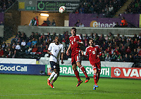 Pictured: Joe Walsh of Wales (C) heads the ball away. Monday 19 May 2014<br />