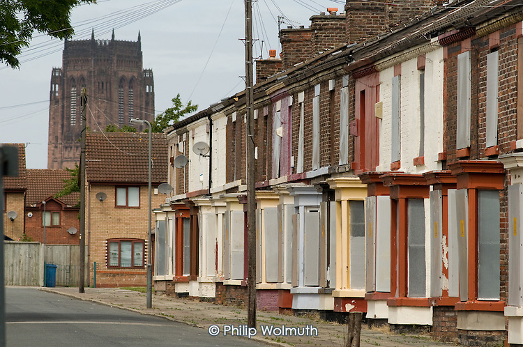 Houses in Liverpool 8, close to the Anglican cathedral and the city centre,  scheduled for demolition by the Merseyside NewHeartlands partnership, financed by the Housing Market Renewal Fund, part of a government strategy aimed at tackling 'low demand'.  Some long-standing residents oppose the demolition of their homes.