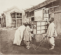 BNPS.co.uk (01202 558833)<br /> Pic: ForumAuctions/BNPS<br /> <br /> Pictured: In many cases, he was the first Westerner the people he photographed had encountered.<br /> <br /> Rarely seen 150 year old photos taken by one of the first British photographers to explore China have emerged for sale for £20,000.<br /> <br /> Scotsman John Thomson (1837-1921) travelled to the Far East in 1868 and established a studio in Hong Kong, using it as a base to explore remote parts of the vast country for the next four years, photographing landmarks, scenery and the native population.<br /> <br /> In many cases, he was the first Westerner the people he photographed had encountered.<br /> <br /> One striking image shows a prisoner in chains with a head poking through a board covered in Chinese symbols, perhaps listing his misdemeanours. In another, a man poses next to a giant camel statue in the grounds around the Ming tombs of the Forbidden City.<br /> <br /> Almost 100 of his photos feature in a rare first edition of 'Thomson Illustrations of China and Its People' (1873), which is going under the hammer with London-based Forum Auctions.