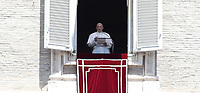 Papa Francesco recita l'Angelus domenicale affacciato su piazza San Pietro dalla finestra del suo studio. Citta' del Vaticano, luglio 14, 2019.<br /> Pope Francis recites the Sunday Angelus noon prayer from the window of his studio overlooking Saint Peter's Square, at the Vatican, on July 14, 2019.<br /> UPDATE IMAGES PRESS/Isabella Bonotto<br /> <br /> STRICTLY ONLY FOR EDITORIAL USE