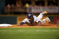 Fort Myers Miracle catcher Brian Navarreto (23) slides head first into third during a game against the Bradenton Marauders on April 9, 2016 at McKechnie Field in Bradenton, Florida.  Fort Myers defeated Bradenton 5-1.  (Mike Janes/Four Seam Images)