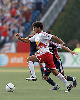 New York Red Bulls midfielder Mehdi Ballouchy (10) dribbles at midfield. In a Major League Soccer (MLS) match, New England Revolution defeated New York Red Bulls, 2-0, at Gillette Stadium on July 8, 2012.