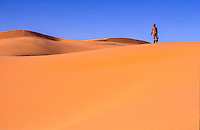 Tuareg on the dune top in Sahara desert, Libya