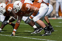 02 September 2006: University of Texas defensive linemen, Brian Robison (39) and Frank Okam (97) take their stance at the line of scrimmage during the Longhorns 56-7 victory over the University of North Texas at Darrell K Royal Memorial Stadium in Austin, TX.