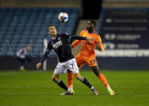 21st November 2020; The Den, Bermondsey, London, England; English Championship Football, Millwall Football Club versus Cardiff City; Sheyi Ojo of Cardiff City marking Jed Wallace of Millwall