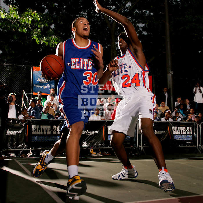 Michael Beasley (30) drives past Corey Stokes (24) during the Elite 24 Hoops Classic game on September 1, 2006 held at Rucker Park in New York, New York.  The game brought together the top 24 high school basketball players in the country regardless of class or sneaker affiliation.